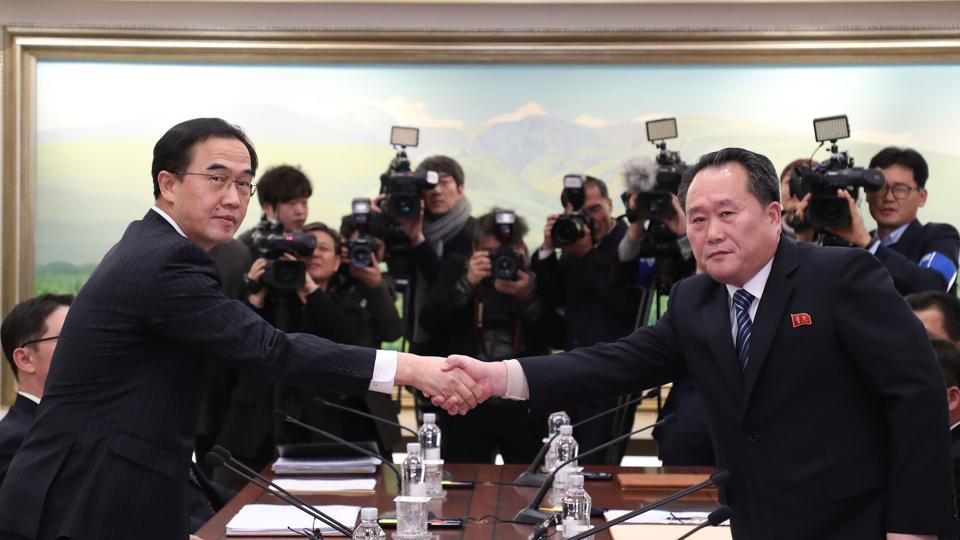 South Korea's Unification Minister Cho Myung-Gyun (L) shakes hands with North Korean chief delegate Ri Son-Gwon during their last meeting at the border truce village of Panmunjom in the Demilitarized Zone (DMZ) dividing the two Koreas on January 9.