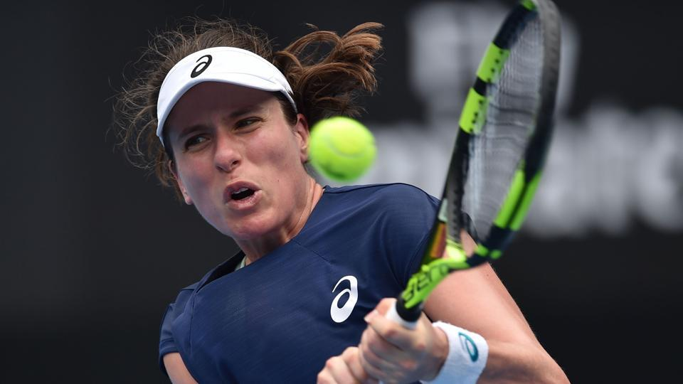 Johanna Konta of Britain hits a return against Agnieszka Radwanska of Poland in their women's singles match at the Sydney International tennis tournament on Tuesday.