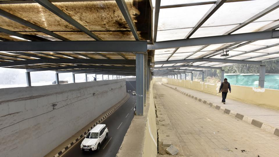 Non-availability of land for constructing slip roads near the four junctions, including Rajiv Chowk, is also delaying the opening of the underpasses for traffic.