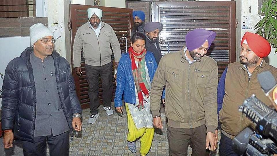 Vigilance bureau officials coming out after conducting a search at former V-C Rajneesh Arora's house in Amritsar on Tuesday.