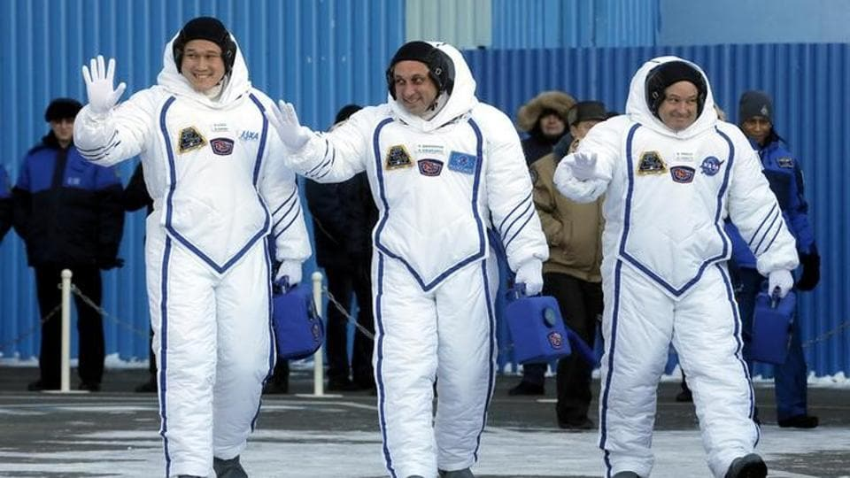 Members of the International Space Station expedition 54/55, Roscosmos cosmonaut Anton Shkaplerov (C), NASA astronaut Scott Tingle (R) and Norishige Kanai (L) of the Japan Aerospace Exploration Agency during the send-off ceremony, in Kazakhstan, in December.