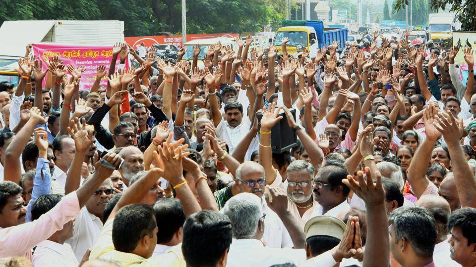Government drivers and conductors along with their family members raise slogans during a protest outside Tamil Nadu State Transport Corporation office, in Coimbatore on Tuesday.