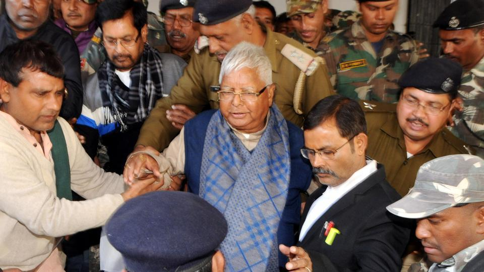 RJD chief Lalu Prasad flanked by security personnel on his way to appear in a special CBI court in Ranchi.