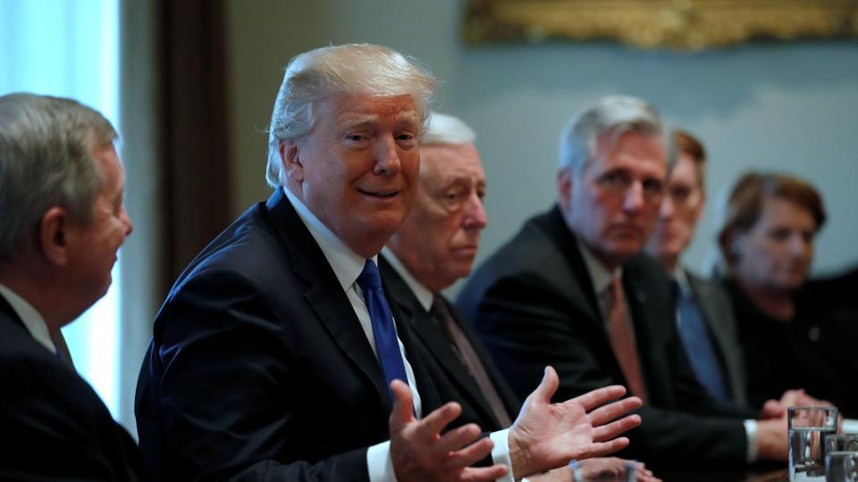 US President Donald Trump holds a bipartisan meeting with legislators on immigration reform at the White House in Washington, on Tuesday.