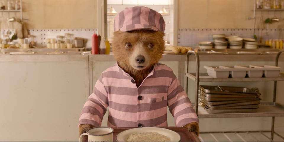 This time around, the beloved bear with the wry British humour has been jailed for stealing a pop-up book. It is up to his adoptive family and a fearsome prison cook to help prove his innocence.