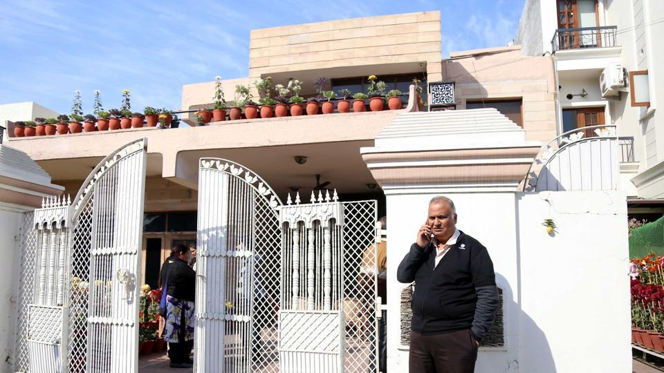 Ajit Jain outside his house in Sector 33 on Wednesday. He was out for some work when the robbers struck there on Tuesday evening.