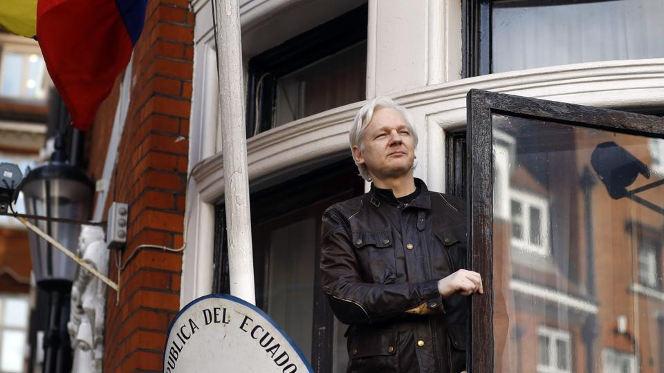 WikiLeaks founder Julian Assange greets supporters outside the Ecuadorian embassy in London on May 19, 2017.