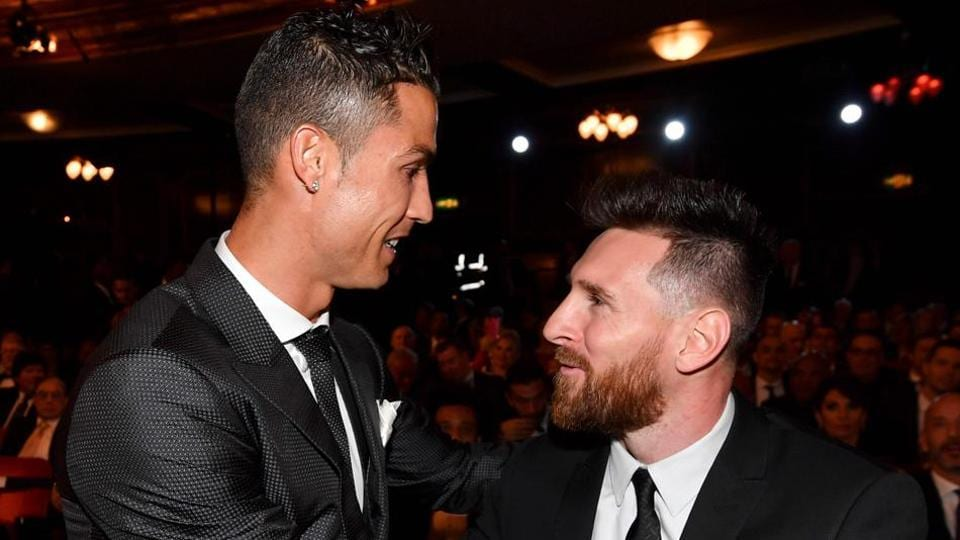 Cristiano Ronaldo (L) and Lionel Messi are both part of the UEFA Fans' Team of the Year.
