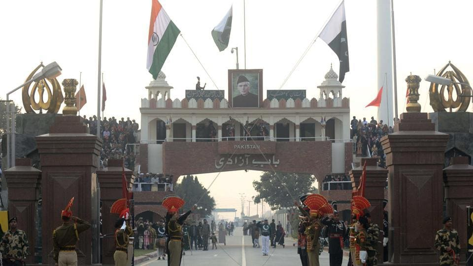 Pakistani Rangers (black uniforms) and Indian Border Security Force personnel (brown uniforms) take part in the daily beating of the retreat ceremony at the India-Pakistan Wagah Border Post, some 35km west of Amritsar, on December 24, 2017.
