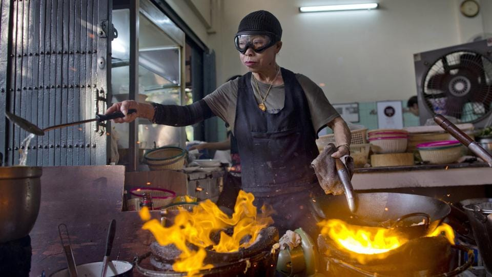 After spending more than three decades cooking in an unassuming outdoor kitchen, wok-wielding, goggles-wearing Thai chef Supinya Jansuta has been propelled to international culinary stardom by having her restaurant 'Jay Fai' awarded a Michelin star. (Gemunu Amarasinghe / AP)