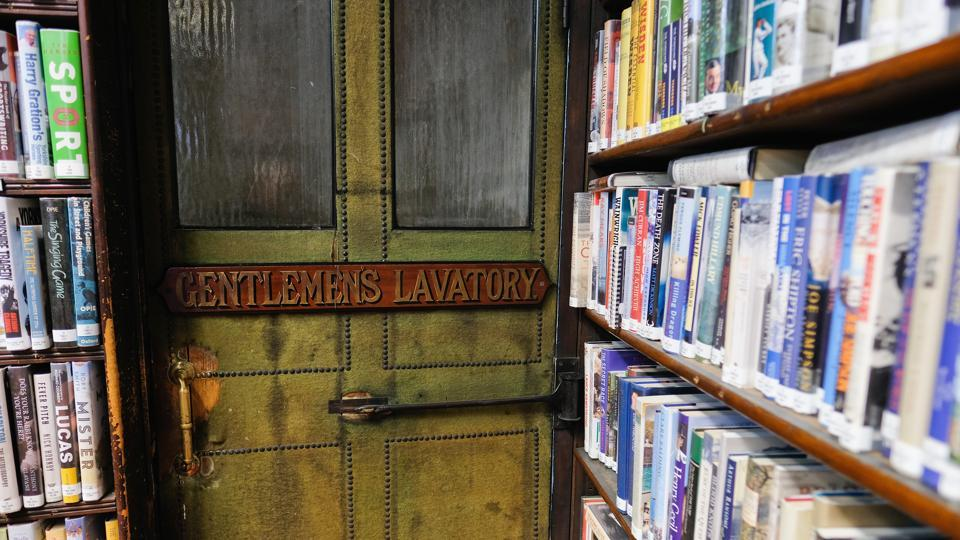 The entrance to the men's lavatory is tucked away between bookshelves inside the Leeds Library. (Ian Forsyth / Getty Images)