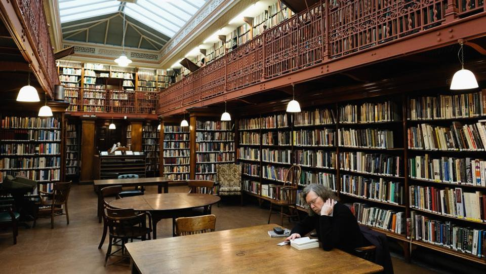 A library member reads in the New Room inside the library. Libraries of this kind were a feature of many towns of UK in the late 18th and early 19th centuries. (Ian Forsyth / Getty Images)
