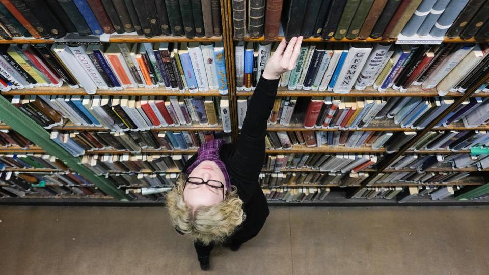 Assistant Librarian, Anna Goodridge straightens the books in the shelves. The Leeds Library's collection is particularly rich in travel, topography, biography, history and literature. (Ian Forsyth / Getty Images)