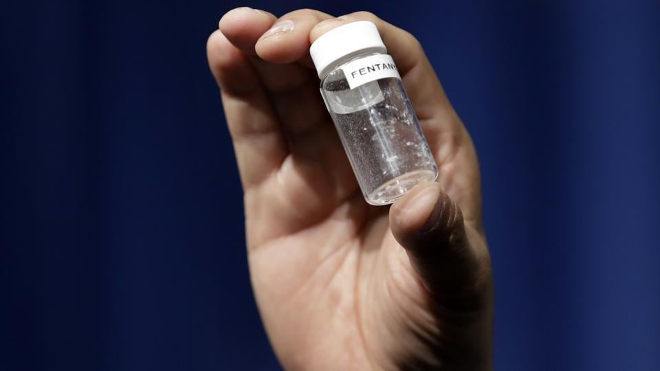 In this June 6, 2017, file photo, a reporter holds up an example of the amount of fentanyl that can be deadly.