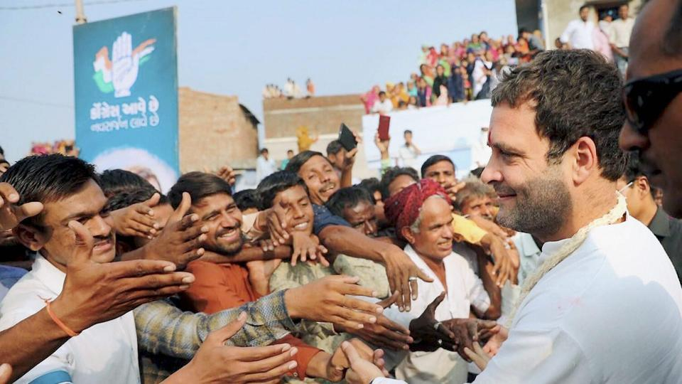 Congress president Rahul Gandhi meeting supporters at a roadshow in Mehsana district during Gujarat election campaign.