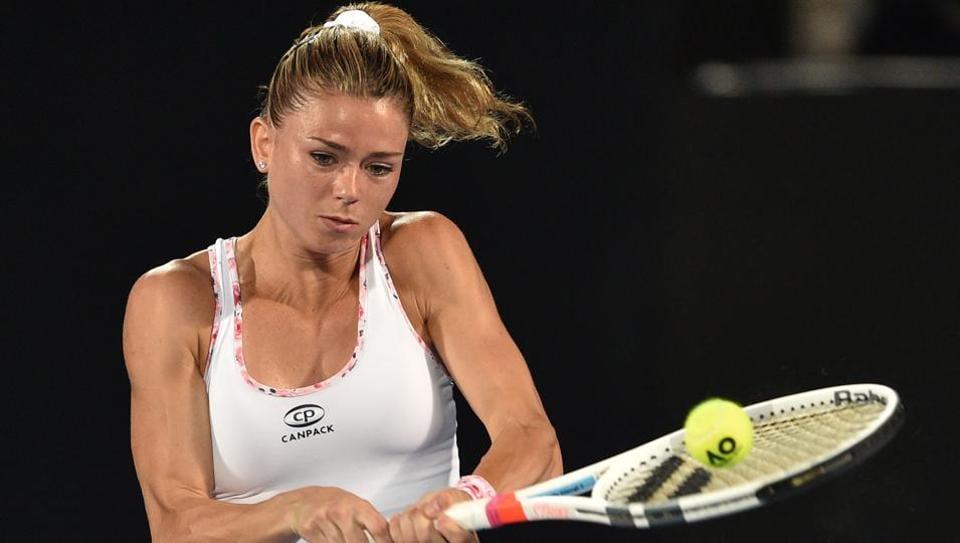 Camila Giorgi of Italy hits a return to Agnieszka Radwanska from Poland during their Sydney International encounter.