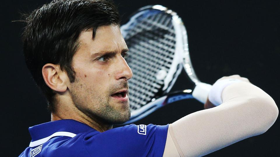 Novak Djokovic warming up for the Australain Open wore a compression sleeve on his troublesome right elbow in his long-awaited return to the tennis court on Wednesday- at the Kooyong Classic and the Tie Break Tens exhibition in Melbourne