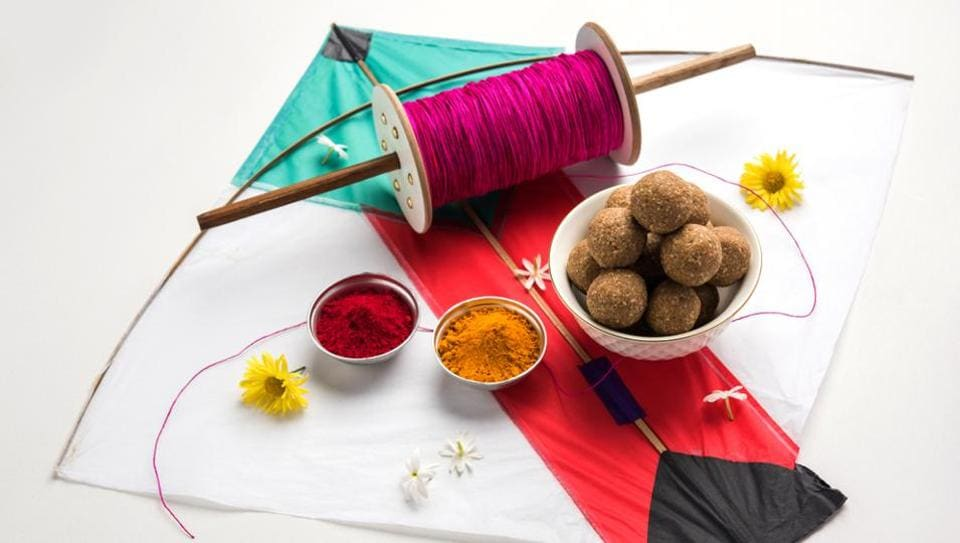 Makar Sankranti is celebrated by flying kites and distributing til gul laddoos.