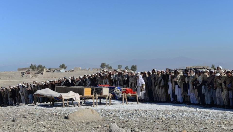 Afghan mourners offer funeral prayers for the victims of a suspected US airstrike in the Achin district of Nangarhar province on January 12, 2018.