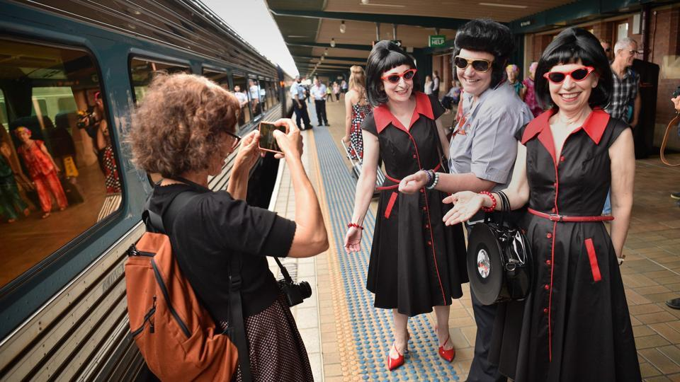 Elvis fans pose for a picture before boarding a train to The Parkes Elvis Festival. The annual extravaganza is billed as the southern hemisphere's biggest tribute to the rock 'n' roll legend -- who died in 1977 -- and attracts thousands of die-hard fans. (Peter Parks / AFP)