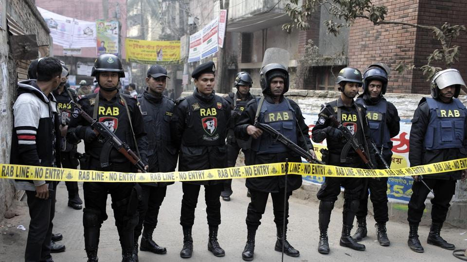 Members of Rapid Action Battalion guard a street during an operation in Dhaka Bangladesh on Friday