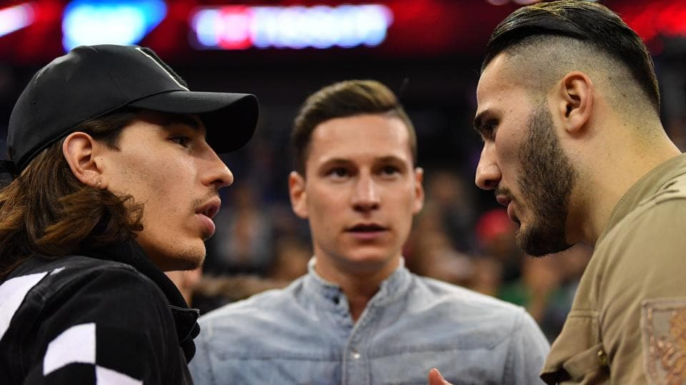 Hector Bellerin (L), Sead Kolasinac (R), both from Arsenal FC, talk with Julian Draxler of Paris Saint-Germain (PSG)during the NBA game between Boston Celtics and Philadelphia 76ers at The O2 Arena in London on Wednesday.
