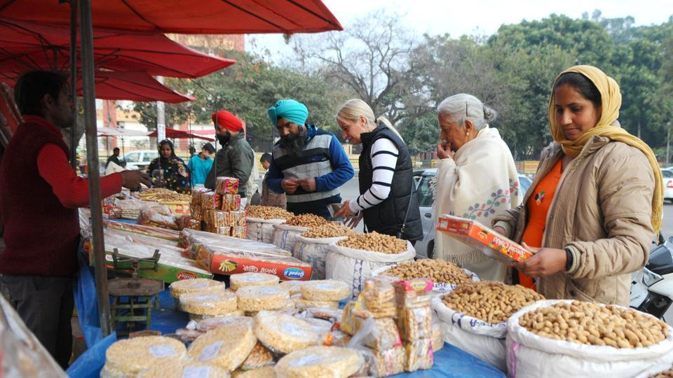 People shop for winter delicacies to celebrate Lohri festival in Chandigarh.  (Anil Dayal / HT Photo)