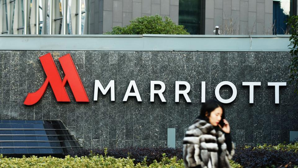 A woman walks past Marriott signage in Hangzhou in China's Zhejiang province.