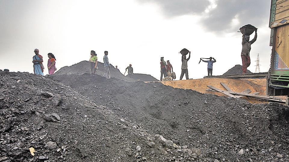 Labourers load a truck with coal at depot in Jaintia Hills, Meghalaya. In the state's political field, all actors are privately conscious of the need to protect the environment, but they publicly want to be seen as favouring the economy.