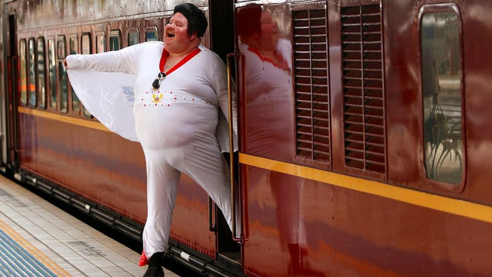 Elvis Presley impersonator Sean Wright poses next to the Elvis Express train at Sydney's Central station before it departs for the 26th annual Elvis Festival being held in the New South Wales town of Parkes in Australia on January 11, 2018. (Daniel Munoz / REUTERS)