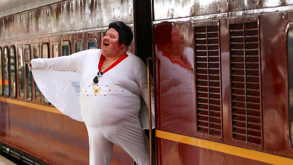 Elvis impersonator Sean Wright poses next to the Elvis Express train at Sydney's Central station. Elvis fans shook up the station with hundreds rocking to his famous tunes before a special train departed for the 26th annual Elvis Festival being held in outback Australia. (Daniel Munoz / REUTERS)