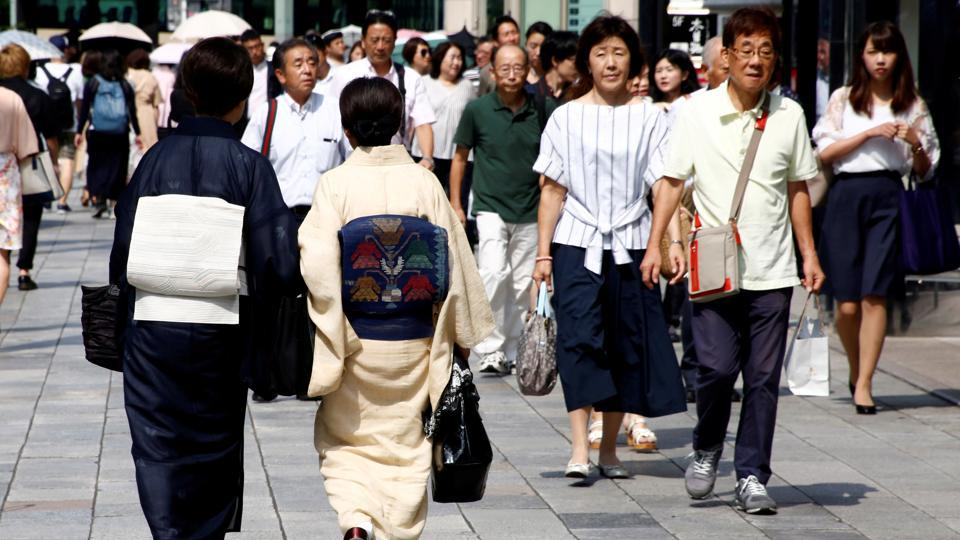 Women make their way at a shopping district in Tokyo, Japan.