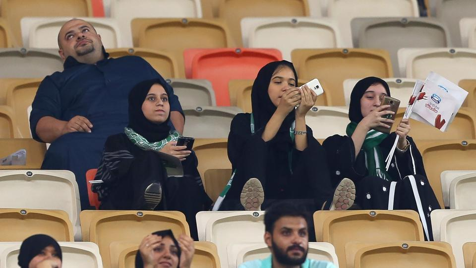 Female Saudi supporters of Al-Ahli attend their teams football match against Al-Batin in the Saudi Pro League at the King Abdullah Sports City in Jeddah on January 12, 2018.