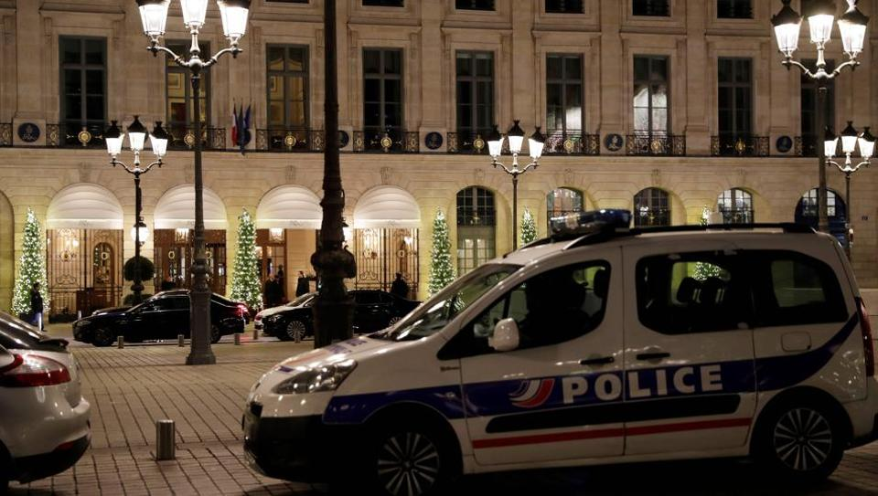 A picture shows a police car parked outside the Ritz luxury hotel in Paris on January 10, 2018, after an armed robbery.