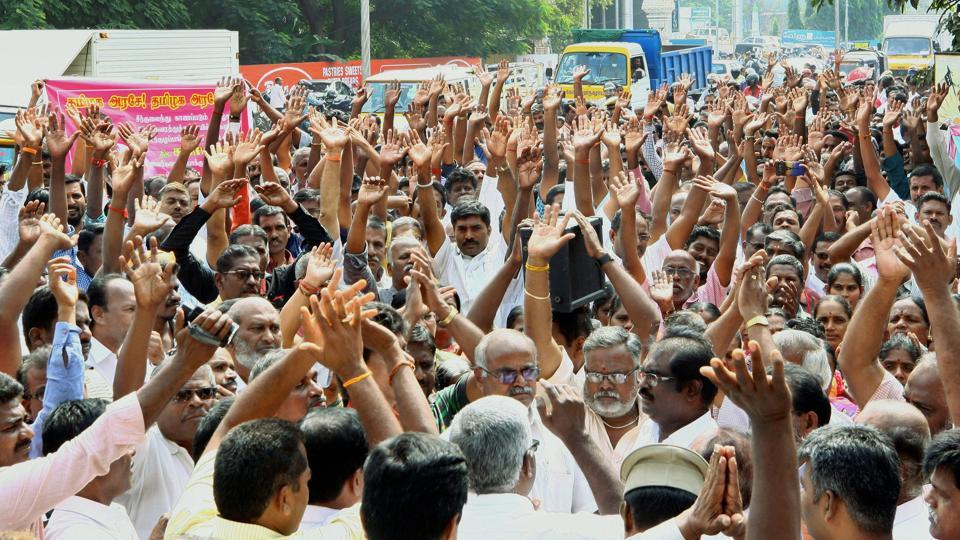 Government drivers, conductors along with their family members raising slogans during a protest outside Tamil Nadu State Transport Corporation office, in Coimbatore on Tuesday.