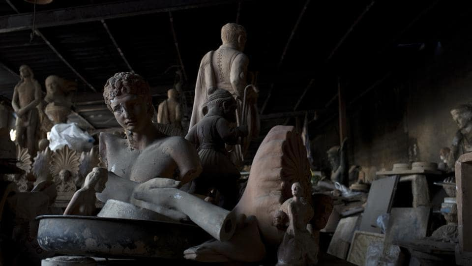 A bust of the ancient Greek messenger of the gods, Hermes (L), stands among other statues and antefixes in Goumas' workshop. Scattered apparently randomly is an Athena here, a horse or a satyr there, among bulls' heads, griffins, sphinxes, garden urns or busts of the philosopher Socrates and the 19th-century Greek poet Dionysios Solomos. There's even a Christ somewhere. (Petros Giannakouris / AP)