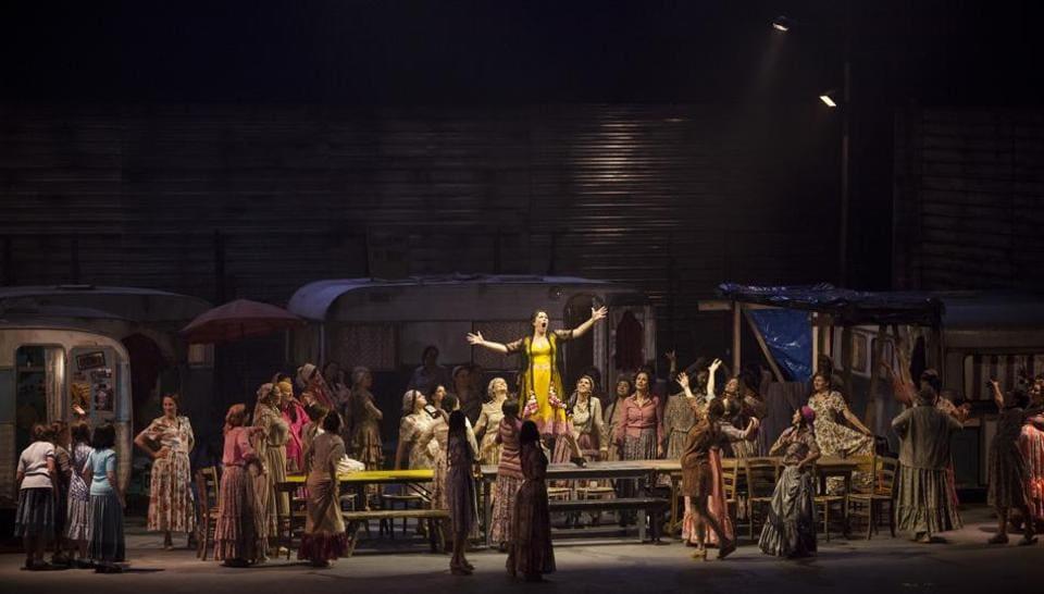 Soprano Veronica Simenoi (centre), performs as Carmen in George Bizet opera at the Maggio Musicale Fiorentino theatre in Florence, Italy.