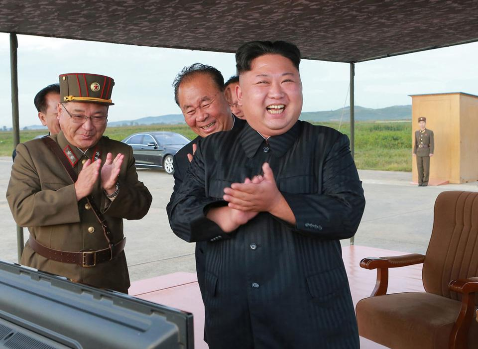 FILE - In this undated file photo distributed on Sept. 16, 2017, North Korean leader Kim Jong Un, right, celebrates what was said to be the test launch of an intermediate range Hwasong-12 missile at an undisclosed location in North Korea.