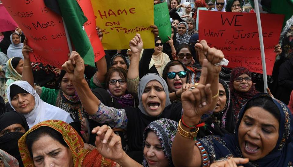 Pakistani civil society activists take part in a protest after a child was raped and murdered in Karachi on January 12, 2018.