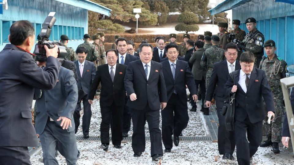 The North Korean delegation led by Ri Son Gwon, Chairman of the Committee for the Peaceful Reunification of the Country (CPRC) of DPRK, crosses the concrete border to attend a meeting at the truce village of Panmunjom in the demilitarised zone separating the two Koreas, on January 9, 2018. (Yonhap via REUTERS)