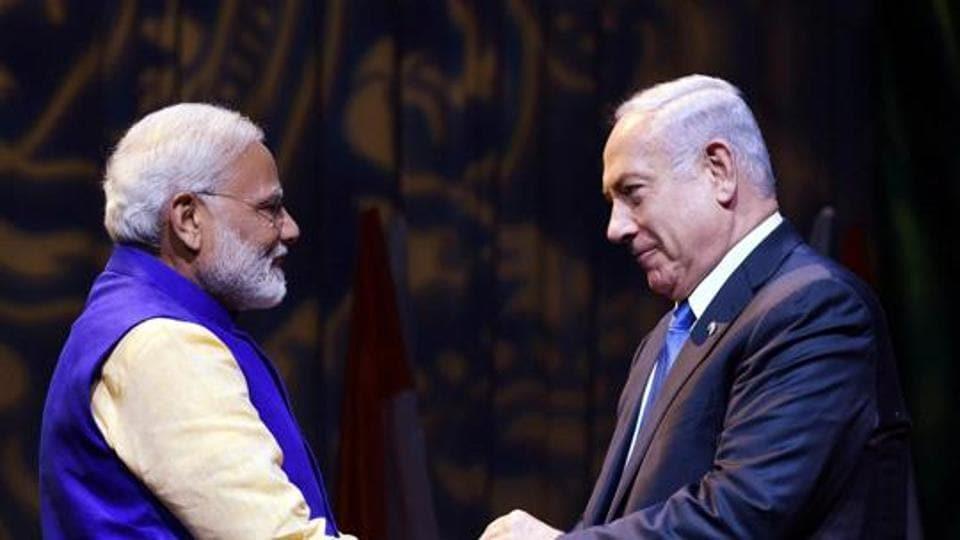 Prime Minister Narendra Modi shakes hands with Israeli Prime Minister Benjamin Netanyahu at the Community Reception Programme, in Tel Aviv, Israel.