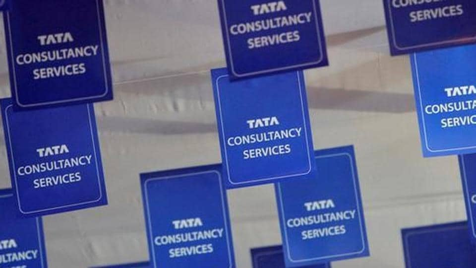 Logos of Tata Consultancy Services (TCS) are displayed at the venue of the annual general meeting of the software services provider in Mumbai, June 29, 2012.