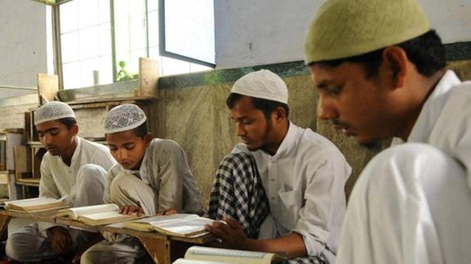 Muslims boys recite Quran at a local madrasa in Noida.