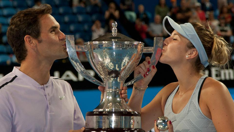 Roger Federer (L) and Belinda Bencic of Switzerland hoist the Hopman Cup after defeating Alexander Zverev and Angelique Kerber of Germany in the mixed doubles final on day eight of the Hopman Cup tennis tournament in Perth on January 6, 2018. (Tony Ashby / AFP)