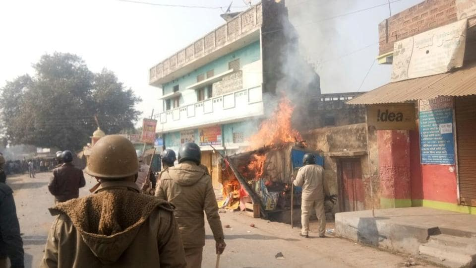 Ashop in Karma Bazar of Allahabad burns as police try to control an agitating mob on Friday.