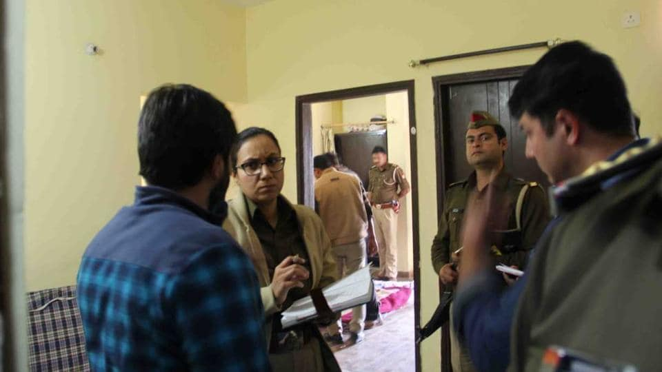 Police at Jitender Mann's rented flat in AVJ Heights, Zeta 1, Greater Noida. Officials said his body had decomposed.