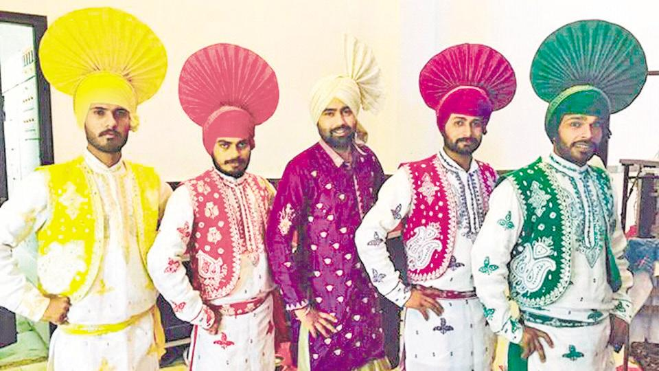 Members of Rabab Bhangra Force group all decked up in traditional attires for a performance.