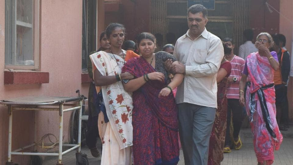 Parents of some of the girls who died when a boat carrying 40 students for a picnic capsized off the coast of Dahanu on Saturday. (Mangesh Lade / HT Photo)