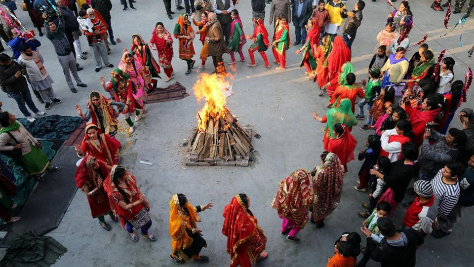 Women perform a traditional folk dance near a bonfire as they celebrate the Lohri festival, which marks the culmination of winter in many parts of northern India, in Jammu. (Mukesh Gupta  /  REUTERS)