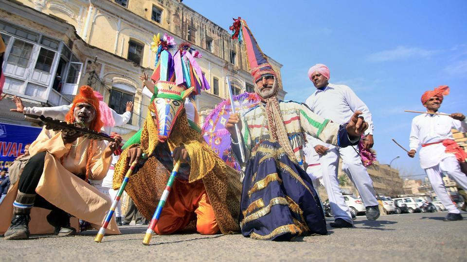 Artists perform a traditional folk dance during Lohri celebrations in Jammu. (PTI)
